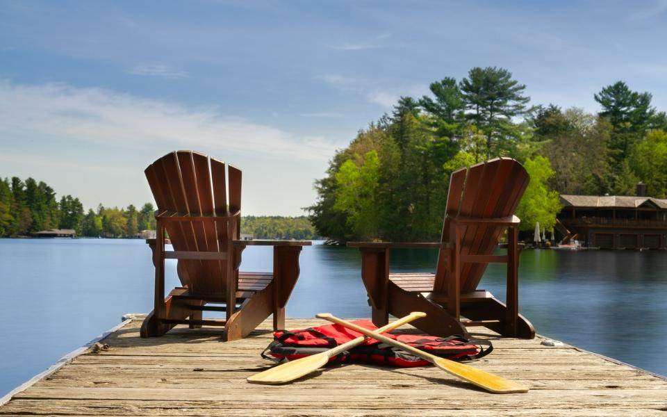 Finance and Real Estate, life after retirement with chairs near the lake